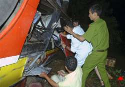 scores killed as bus plunges into river bank length