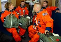 shuttle astronauts busy with space station stockpiling
