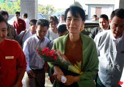 suu kyi registers party makes first parliament visit