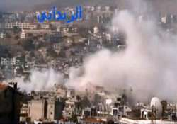 syrian forces battle rebels near damascus