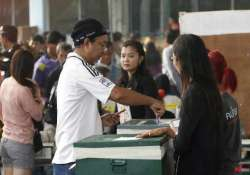 thailand holds polls smoothly in opposition strongholds