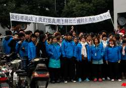 workers mass at shanghai factory in latest unrest