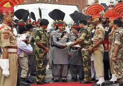 bsf pak rangers exchange eid sweets at wagah in hush hush