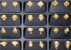 bihar deputy director gifts wife 230 gold ear rings one for