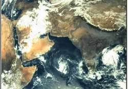 isro s mars orbiter sends first picture of earth cyclone