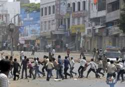 clashes in kanpur over torn religious poster