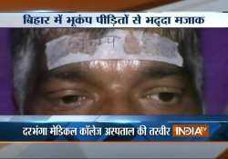 probe ordered into pasting of bhukamp sticker on injured in
