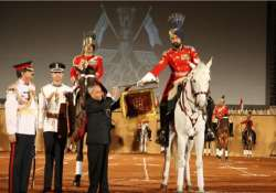 president presents silver trumpet and banner to president s