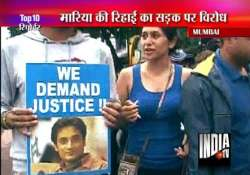supporters of slain neeraj grover hold protest rally