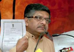 bjp blames pm s conspiracy of silence for graft