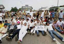 aiims issue congress workers stage protest burn dy cm s