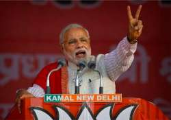 live pm modi addresses an election rally at delhi s