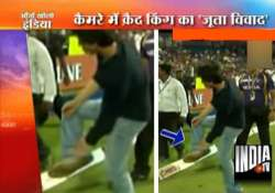elated shahrukh does a somersault makes a shoe gesture at a