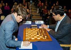 anand draws seventh game carlsen remains two points ahead