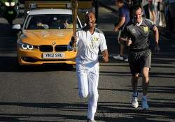 olympic torch becomes cultural happening in uk