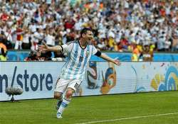 fifa world cup messi magic helps argentina top group