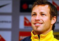 lucas neill to fight to retain socceroos captaincy