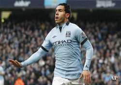 tevez charged with driving offence
