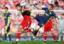 wigan upsets liverpool 2 1 to boost survival hopes