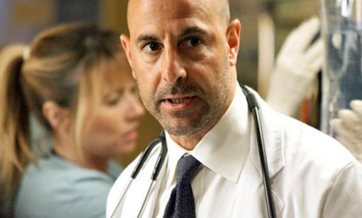 stanley tucci to work in heat