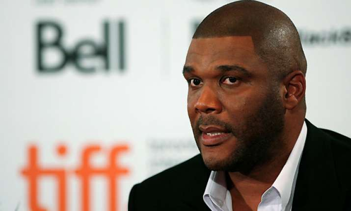 tyler perry offers support to boy in abuse case