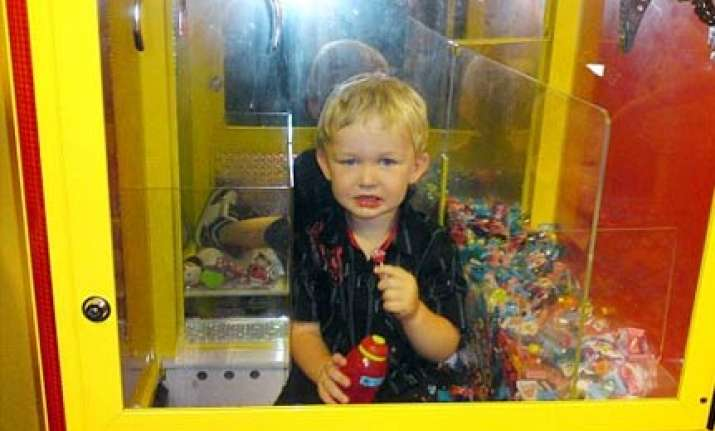 australian toddler trapped inside lolly machine while