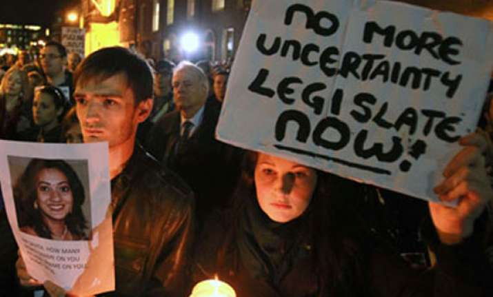 hundreds hold protest march outside irish parliament over