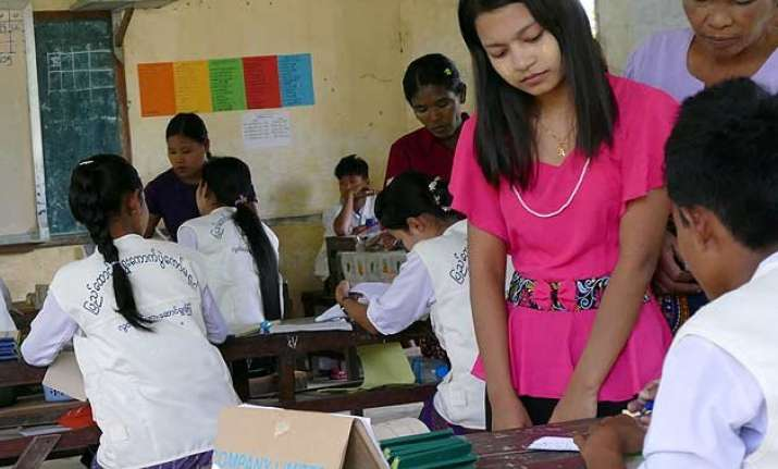with excitement and hope millions vote in myanmar polls