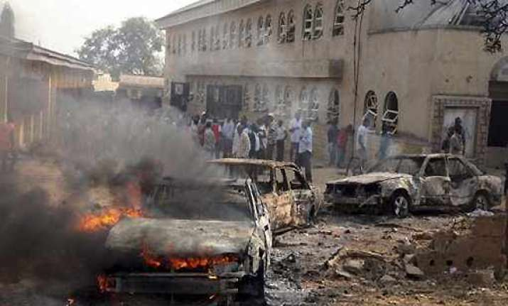20 killed as suicide car bomber targets catholic church in