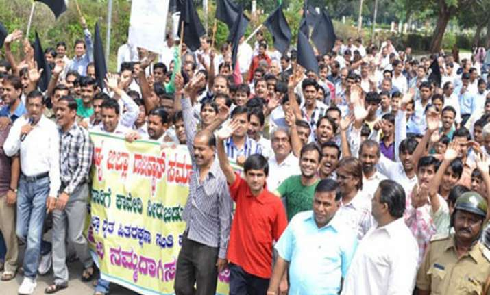 tension protests in karnataka after sc orders release of