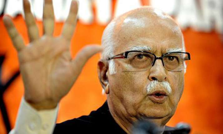 advani hits back at omar over article 370