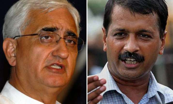 khurshid returns to delhi vows to fight back legally