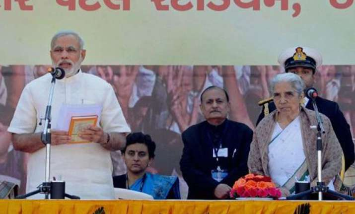 narendra modi takes charge of gujarat again for fourth term