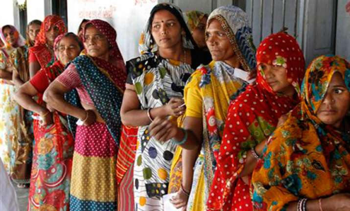 gujarat polls record 67 per cent turnout in modi versus