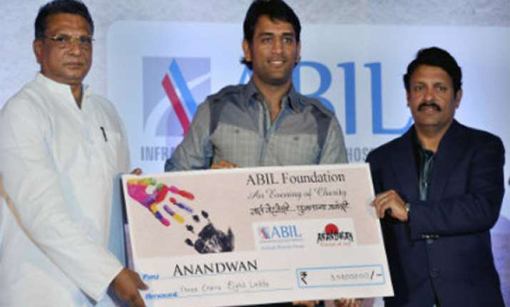dhoni hands over rs 3 cr to baba amte s ngo
