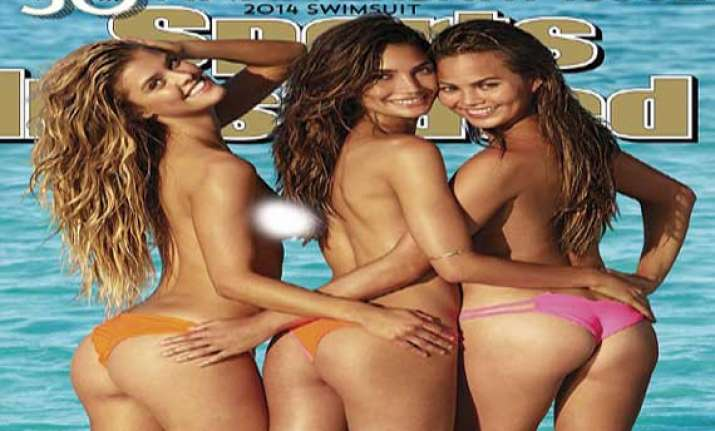cheeky girls go topless for sports illustrated swimsuit