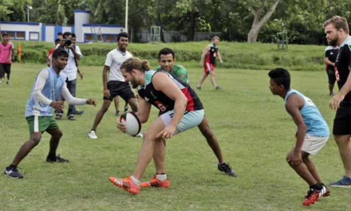 harlequin fc gives rugby lessons to kolkata kids
