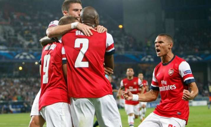 arsenal beats montpellier 2 1 in champions league