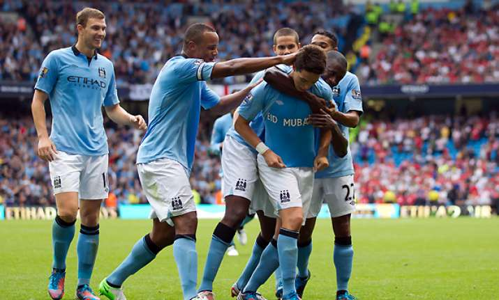 man city recovers to open title defence with win