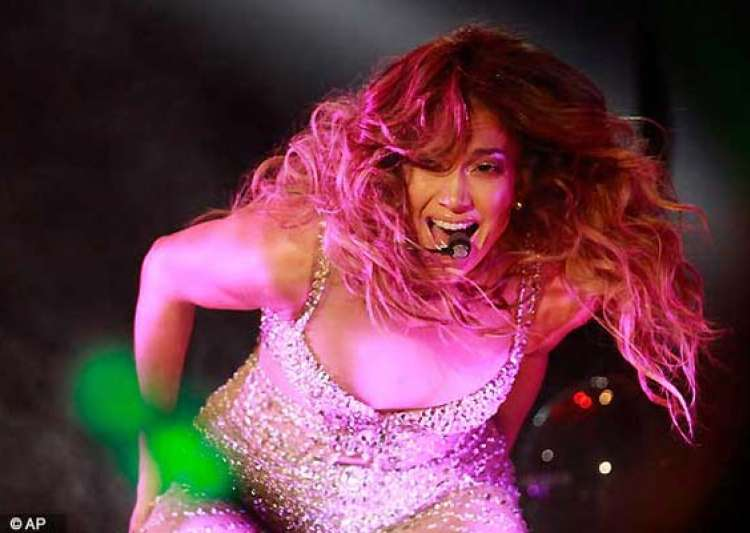 jennifer lopez stuns fans in shanghai with a glittering cane