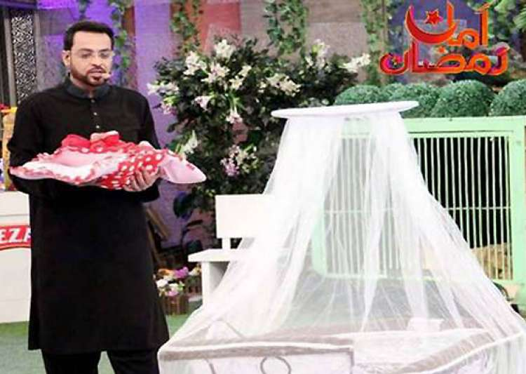 furore over pak tv quiz show host gifting orphan baby to- India Tv