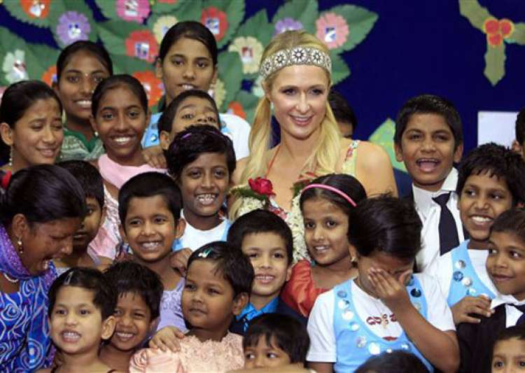 paris hilton dances with orphans prays at siddhivinayak