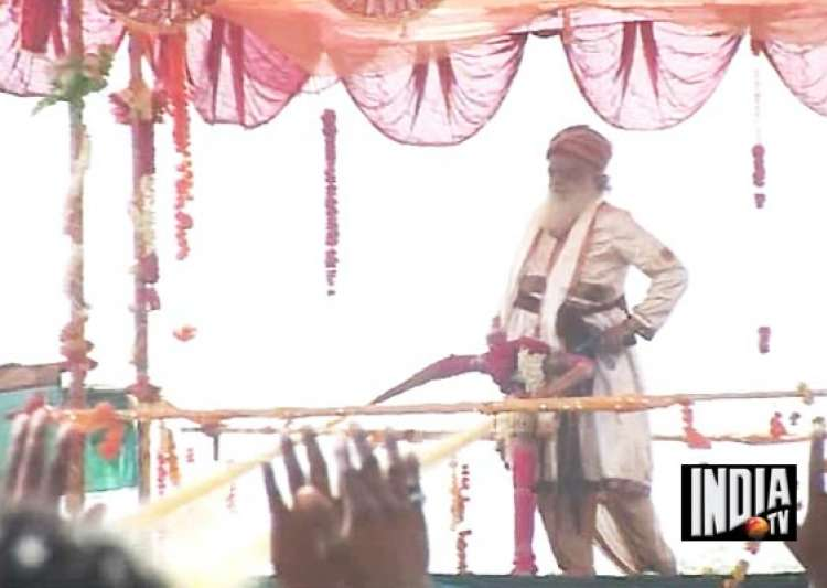 self styled godman asaram bapu again wastes lakhs of litres of water spraying on devotees in surat- India Tv