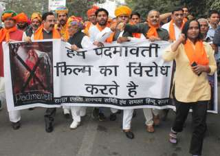 Members of Rajput community raise slogans and...