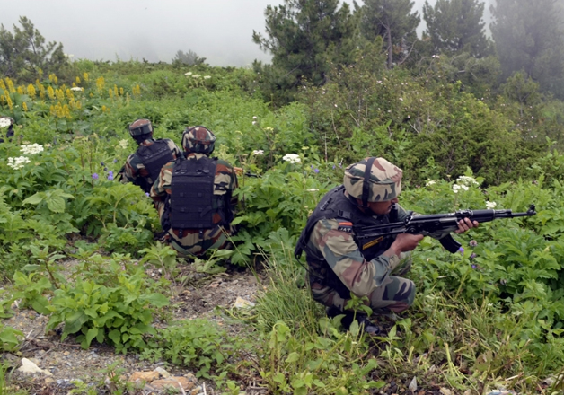 File pic - Indian jawans retaliate to Pakistani firing