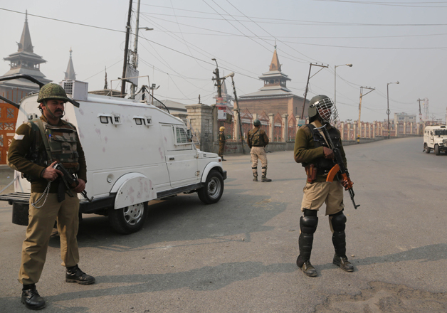 Indian paramilitary troopers stand guard outside Jamia
