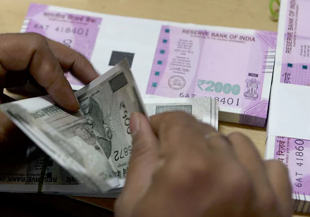 A bank employee counts new notes of Rs 500 and Rs 2000