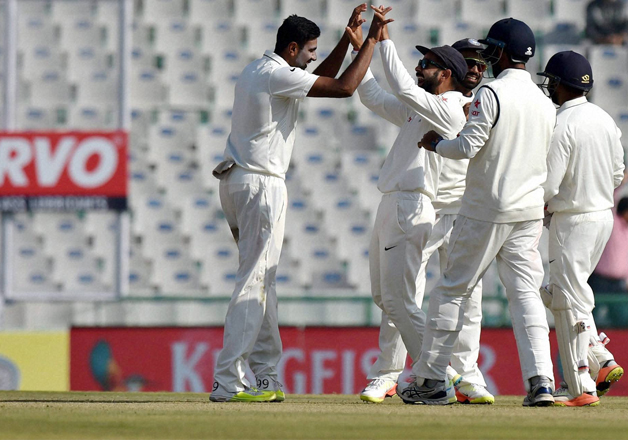 R Ashwin celebrates with team mates dismissal of England's