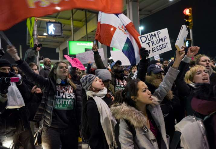 India Tv - Protesters block an intersection near Terminal 4 at JFK Airport, New York
