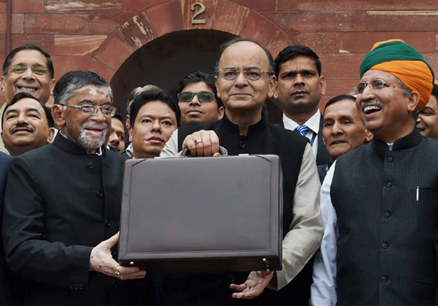 Jaitley stands outside his office at North Block